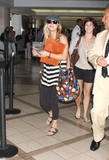 http://img106.imagevenue.com/loc1161/th_05700_Kaley__Cuoco_at_LAX_HOPE_367_122_1161lo.jpg