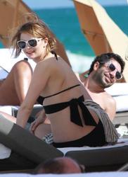 http://img106.imagevenue.com/loc518/th_531129614_1IBN152AOK_Mischa_Barton_Wearing_a_Bikini_in_Miami009_122_518lo.jpg