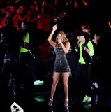 Mariah Carey shows legs and cleavage as she performs during MTV Video Music Awards Japan 2008 in Saitama
